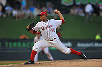 Pitcher Luis Ramos (40) of the Greenville Drive delivers a pitch in a game against the Asheville Tourists on Thursday, August 13, 2015, at Fluor Field at the West End in Greenville, South Carolina. Asheville won, 8-1. (Tom Priddy/Four Seam Images)