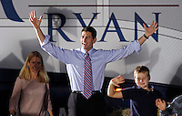 Republican vice presidential candidate Paul Ryan, middle, walks on stage with his wife Janna, left, and son Sam, right, during a campaign stop Thursday evening at the Crutchfield Corporation in Albemarle County, Va.