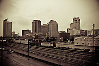 Partial Skyline of Birmingham, Alabama in Sepia including the train tracks that divide the city's north and south sides.