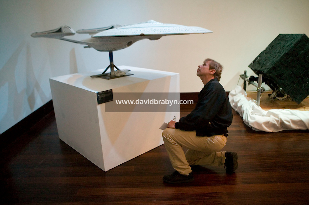 2 October 2006 - New York City, NY - Nick Zmuda examines a filming miniature of the Starship Entreprise-E on display at the preview of items from the TV show Star Trek at Christie's auction house in New York City, USA, 2 October 2006. The auction, on October 5-7, celebrates the show's 40th anniversary. The model is expected to fetch between $8,000 and $12,000.