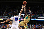 13 March 2015: Notre Dame's Jerian Grant (22) shoots over Duke's Jahlil Okafor (15). The Notre Dame Fighting Irish played the Duke University Blue Devils in an NCAA Division I Men's basketball game at the Greensboro Coliseum in Greensboro, North Carolina in the ACC Men's Basketball Tournament semifinal game. Notre Dame won the game 74-64.