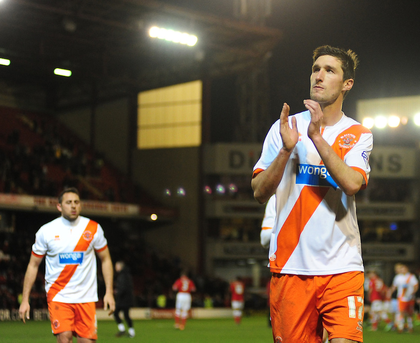 Blackpool's Chris Basham looks dejected at the final whistle<br /> <br /> Photo by Chris Vaughan/CameraSport<br /> <br /> Football - The Football League Sky Bet Championship - Barnsley v Blackpool - Saturday 18th January 2014 - Oakwell Stadium - Barnsley<br /> <br /> &copy; CameraSport - 43 Linden Ave. Countesthorpe. Leicester. England. LE8 5PG - Tel: +44 (0) 116 277 4147 - admin@camerasport.com - www.camerasport.com