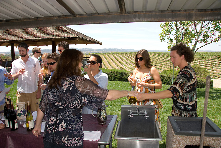 California, San Luis Obispo County: At Eberle Winery and vineyards in Paso Robles, noted for red wines. People tasting wine..Photo caluis126-70786. .Photo copyright Lee Foster, www.fostertravel.com, 510-549-2202, lee@fostertravel.com