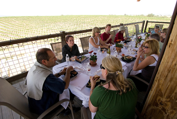 California, San Luis Obispo County: At Eberle Winery and vineyards in Paso Robles, noted for red wines.  Lunch on deck at winery with vineyards in background..Photo caluis139-71934.Photo copyright Lee Foster, www.fostertravel.com, 510-549-2202, lee@fostertravel.com