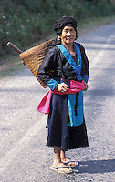 Laos, Udom Xai Province, Na Mor..Hmong older lady in her finest working clothes on new road...Photo by Kees Metselaar, 2003