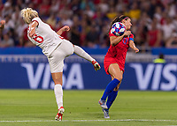 LYON,  - JULY 2: Millie Bright #6 clears the ball away from Alex Morgan #13 during a game between England and USWNT at Stade de Lyon on July 2, 2019 in Lyon, France.