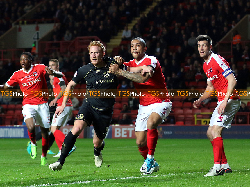 Josh MaGennis of Charlton wrestles with Dean Lewington as they await an MK Dons corner during Charlton Athletic vs MK Dons, Sky Bet EFL League 1 Football at The Valley on 4th April 2017
