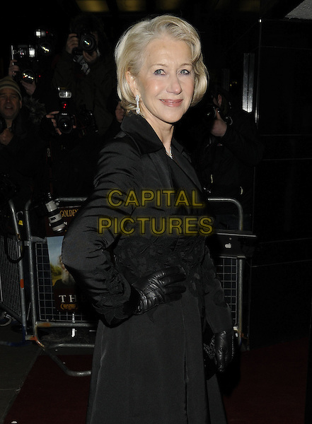 DAME HELEN MIRREN .The UK Premiere of 'The Last Station' at The Curzon Mayfair Cinema, London, England..January 26th 2010.half length black coat velvet side gloves hand on hip.CAP/CAN.©Can Nguyen/Capital Pictures.