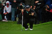 Shane Lowry beckons to his caddy as he lines up his putt on the 18th green during the Final Round of the 3 Irish Open on 17th May 2009 (Photo by Eoin Clarke/GOLFFILE)