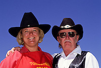 Portrait of a cowboy couple with hats in Tombstone wild west   outdoor museum in Arizona, USA
