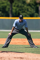 Base umpire Charlie Tierney during an Instructional League game between the Atlanta Braves and Pittsburgh Pirates at Pirate City on October 14, 2011 in Bradenton, Florida.  (Mike Janes/Four Seam Images)