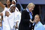 05 November 2014: UNC head coach Sylvia Hatchell (right) laughs as freshman Jamie Cherry (putting on #14) forgot her game jersey and was unable to make her college debut on the first try. The University of North Carolina Tar Heels hosted the Carson-Newman University Eagles at Carmichael Arena in Chapel Hill, North Carolina in an NCAA Women's Basketball exhibition game. UNC won the game 88-27.