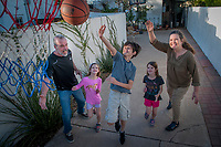 Carol and Jack Friedman spend quality time with their grandchildren Sam, 9, Julia, (black shirt); and Emilia Root (pink shirt) both 7, playing basketball, doing homework and playing games among many activities.