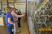 NWA Democrat-Gazette/BEN GOFF @NWABENGOFF<br /> Mindi Dearing (from left), with Beaver Water District, Tony Beringer with B Scene Media and Tiffany Webb with Beaver Water District, look at a map of the Beaver Lake watershed Monday, May 8, 2017, during a press conference to kick off National Drinking Water Week at the Beaver Water District offices and Water Education Center in Lowell. The event highlighted a new public education camaign and recognized the hard work of the staff at Beaver Water District and the four cities, Bentonville, Rogers, Springdale and Fayetteville, that buy water from the district.
