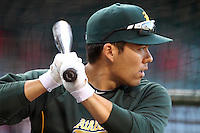 Kurt Suzuki  #8 of the Oakland Athletics takes batting practice before a game against the Los Angeles Angels at Angel Stadium on April 19, 2012 in Anaheim,California. Oakland defeated Los Angeles 4-2.(Larry Goren/Four Seam Images)