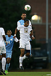 12 September 2014: Pitt's Raj Kahlon (CAN) (14) and North Carolina's Raby George (SWE) (behind) challenge for a header. The University of North Carolina Tar Heels hosted the Pittsburgh University Panthers at Fetzer Field in Chapel Hill, NC in a 2014 NCAA Division I Men's Soccer match. North Carolina won the game 3-0.