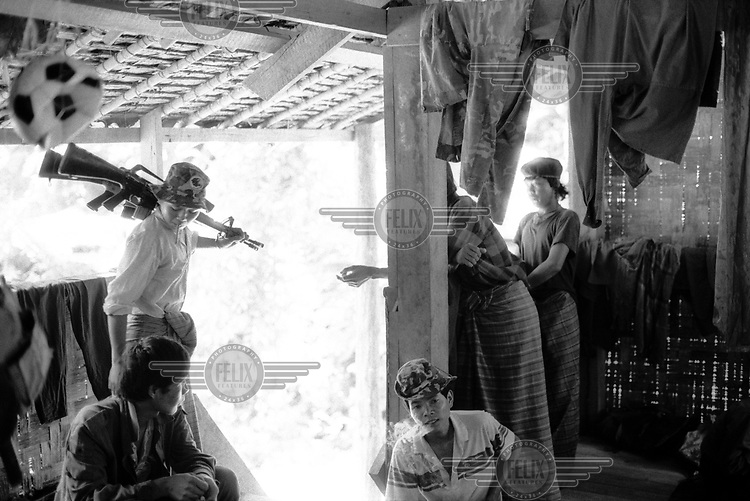 Karenni Army guerrillas in a rest camp close to the Thai/Karenni frontier.
