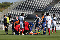 Both sets of players look on as Ross McCrorie of Scotland receives treatment on the pitch during England Under-18 vs Scotland Under-20, Toulon Tournament Semi-Final Football at Stade Parsemain on 8th June 2017