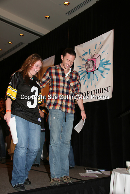 Tom Pelphrey and fan do a skit on stage - So Long Springfield event celebrating 7 wonderful decades of Guiding Light which brought out Guiding Light Actors as they  came to see fans at the Hyatt Regency in Pittsburgh, PA. for Q & A, acting scenes between actors and fans by GL finest during the weekend of October 25, 2009. (Photo by Sue Coflin/Max Photos)
