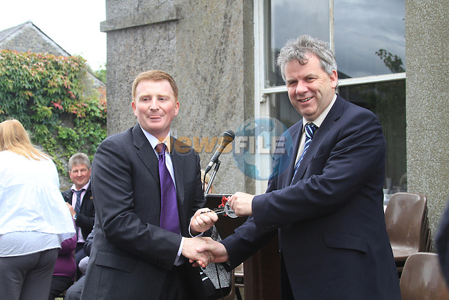 The Handing over of the keys to the old parocial House to the Dunleer community.Tony Mallon and Micheal O'Dowd hands over the Key.Picture Fran Caffrey www.newsfile.ie