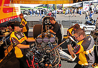 Feb. 17 2012; Chandler, AZ, USA; Crew members work on the car of funny car driver Jeff Arend on the first day of the NHRA Arizona Nationals at Firebird International Raceway. Mandatory Credit: Mark J. Rebilas-