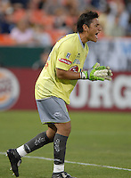 Monarcas Morelia goalkeeper Moises Munoz screams to his team mates to form  a wall during a free kick. Monarcas Morelia tied DC United 1-1 in the SuperLiga opening match in group B, at RFK Stadium in Washington DC, Wednesday July 25, 2007.