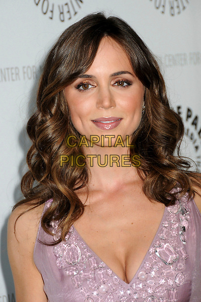 "ELIZA DUSHKU.The 26th Annual William S. Paley Television Festival presents ""Dollhouse"" held at Arclight Cinemas. .Hollywood, CA, USA, .15th April 2009..portrait headshot cleavage lilac purple pink wavy hair lipstick .CAP/ADM/BP.©Byron Purvis/Admedia/Capital Pictures"