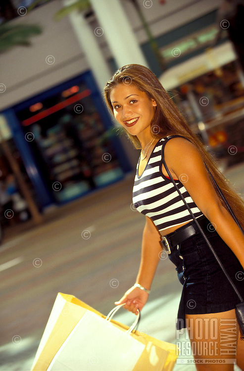 Teenager shopping at the mall.