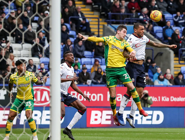 Bolton Wanderers' Josh Magennis competing with Norwich City's KennyMcLean  <br /> <br /> Photographer Andrew Kearns/CameraSport<br /> <br /> The EFL Sky Bet Championship - Bolton Wanderers v Norwich City - Saturday 16th February 2019 - University of Bolton Stadium - Bolton<br /> <br /> World Copyright © 2019 CameraSport. All rights reserved. 43 Linden Ave. Countesthorpe. Leicester. England. LE8 5PG - Tel: +44 (0) 116 277 4147 - admin@camerasport.com - www.camerasport.com