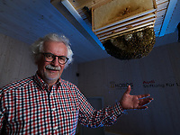 Portrait of Professor Jurgen Tautz, Hobos, University of W&uuml;rzburg, next to the colony installed in the experimental building. This experience allows for constant monitoring by thermal, infrared and 3D cameras of the bees' activities in the nest and also their sorties throughout the year. In Cooperation between the University at W&uuml;rzburg and the  <br />