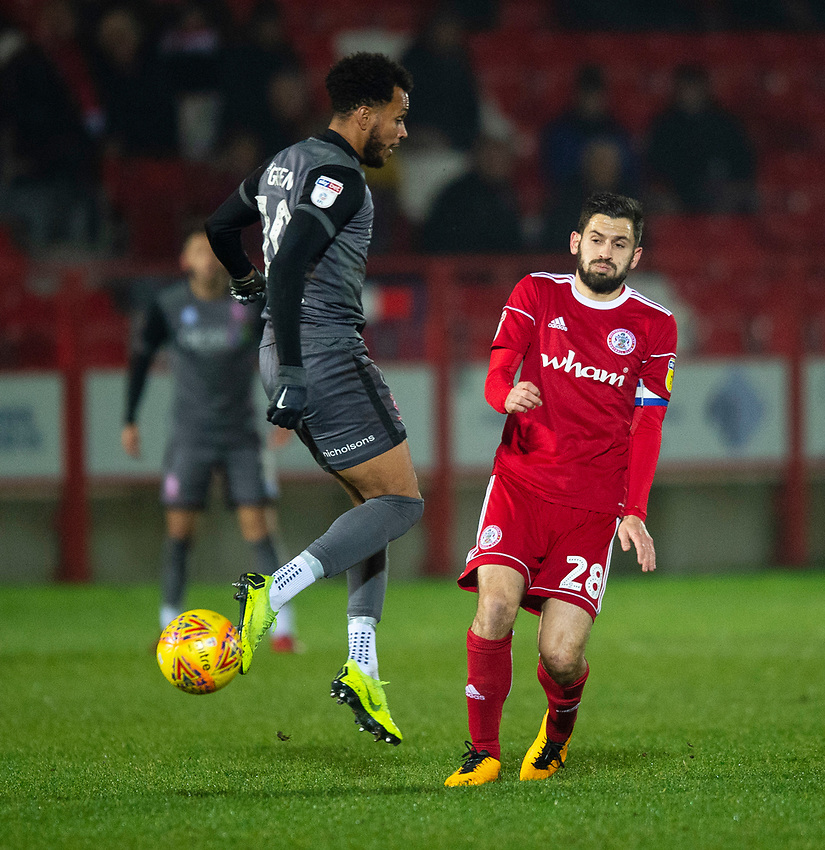 Lincoln City's Matt Green vies for possession with Accrington Stanley's Seamus Conneely<br /> <br /> Photographer Andrew Vaughan/CameraSport<br /> <br /> The EFL Checkatrade Trophy Second Round - Accrington Stanley v Lincoln City - Crown Ground - Accrington<br />  <br /> World Copyright © 2018 CameraSport. All rights reserved. 43 Linden Ave. Countesthorpe. Leicester. England. LE8 5PG - Tel: +44 (0) 116 277 4147 - admin@camerasport.com - www.camerasport.com