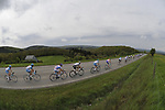 The main bunch pass through the Belgian countryside during the 95th running of Liege-Bastogne-Liege cycle race, 26th April 2009 (Photo by Eoin Clarke/NEWSFILE)