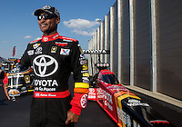 Sep 13, 2013; Charlotte, NC, USA; NHRA top fuel dragster driver Antron Brown poses for a portrait prior to qualifying for the Carolina Nationals at zMax Dragway. Mandatory Credit: Mark J. Rebilas-