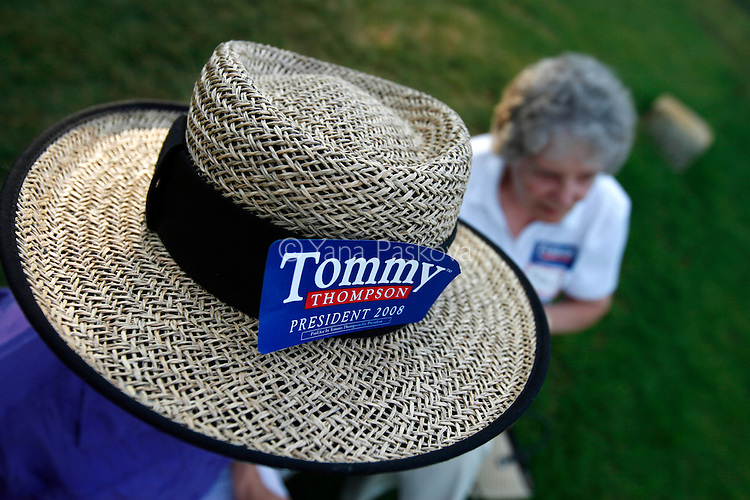 Republican Presidential hopeful Tommy Thompson (R-WI) planned to campaign in Ames, Iowa, on July 06, 2007, until a plane malfunction thwarted his plans.  Two of his supporters wait at the grounds on which he was scheduled to speak.