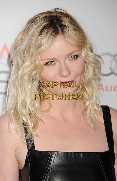 Kirsten Dunst.AFI Fest 2011 - Los Angeles Time Young Hollywood Panel held at Grauman's Chinese Theatre, Hollywood, California, USA..November 4th, 2011.headshot portrait black leather sleeveless red lipstick wavy hair .CAP/ROT/TM.©Tony Michaels/Roth Stock/Capital Pictures