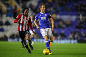 1st November 2017, St. Andrews Stadium, Birmingham, England; EFL Championship football, Birmingham City versus Brentford; Maikel Kieftenbeld of Birmingham City looks for his options as Romaine Sawyers of Brentford comes in at pace to steal the ball