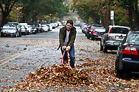 A man clean the street as Hurricane Sandy begins to affect the area in Jersey City, United States. 29/10/2012. Photo by Kena Betancur/VIEWpress.