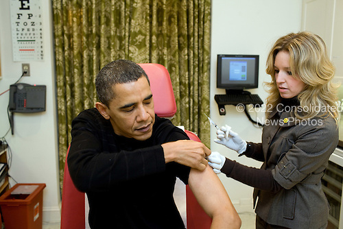 Washington, DC - December 20. 2009 -- A White House nurse prepares to administer the H1N1 vaccine to United States President Barack Obama at the White House on Sunday, December 20, 2009..Mandatory Credit: Pete Souza - White House via CNP
