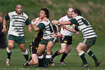 Tim Nanai Williams has Mark Selwyn in support as he tries to break out of Jeremy Biggelaar's tackle. Counties Manukau Premier Club Rugby game between Bombay & Manurewa played at Bombay on Saturday June 14th 2008..Bombay won 19 - 12 after leading 12 - 0 at halftime.