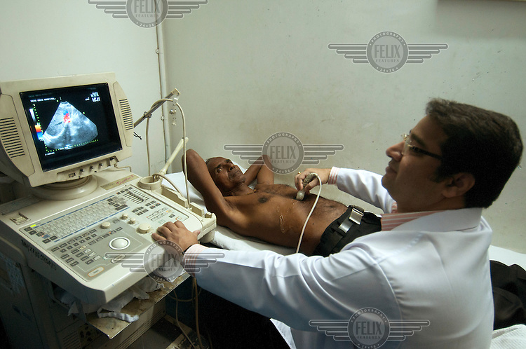 A patient undergoing an ultrasound examination in the radiology department of the Tata Main Hospital.