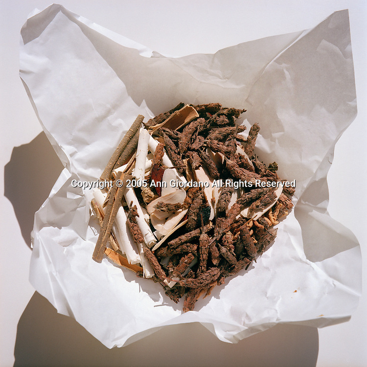 Uncooked Chinese herbs in paper packaging