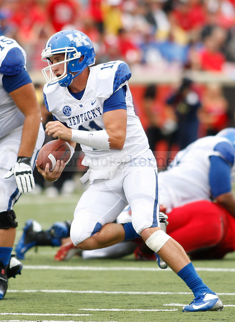 Sophomore quarterback Maxwell Smith runs with the ball during the first half of the UK vs. UL football game at Papa John's Cardinal Stadium in Louisville, Ky., on Sunday, September 2, 2012. Photo by Tessa Lighty | Staff