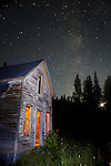 Starry skies and moonset over an abandoned house at the ghost town of Ironton, Colorado