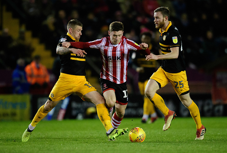 Lincoln City's Shay McCartan is fouled by Newport County's Scot Bennett<br /> <br /> Photographer Chris Vaughan/CameraSport<br /> <br /> The EFL Sky Bet League Two - Lincoln City v Newport County - Saturday 22nd December 201 - Sincil Bank - Lincoln<br /> <br /> World Copyright © 2018 CameraSport. All rights reserved. 43 Linden Ave. Countesthorpe. Leicester. England. LE8 5PG - Tel: +44 (0) 116 277 4147 - admin@camerasport.com - www.camerasport.com
