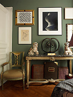 In a corner of the drawing room stands a 1780s French table which belonged to Nicolo's grandmother. On it stands a bronze sculpture, 'Becoming', by Manuela Zervudachi. Above hangs a photograph by Hiroshi Sugimoto