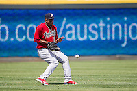 Memphis Redbirds outfielder Oscar Taveras #15 stops short to prevent the ball from going past him during the Pacific Coast League baseball game against the Round Rock Express on April 27, 2014 at the Dell Diamond in Round Rock, Texas. The Express defeated the Redbirds 6-2. (Andrew Woolley/Four Seam Images)