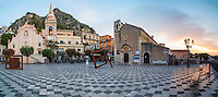 Taormina at sunrise, panoramic photo of the Church of St Joseph (left) and St Augustine's Church (right) in Piazza IX Aprile on Corso Umberto, the main street in Taormina, Sicily, Italy, Europe. This is a panoramic photo of Taormina at sunrise, showing the Church of St Joseph (left) and St Augustine's Church (right) in Piazza IX Aprile on Corso Umberto, the main street in Taormina, Sicily, Italy, Europe