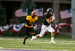 SIOUX FALLS, SD - SEPTEMBER 8: Max Mickey #22 from the University of Sioux Falls breaks loose past Etienne Ezeff #1 from Northern State for an 87 yard touchdown in the first half of their game Saturday night at Bob Young Field in Sioux Falls. (Photo by Dave Eggen/Inertia)