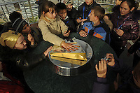 Children put their hands into the print of the country's leader Nursultan Nazaarbayev in the top of the Bayterek tower in Astana, the capitol of Kazakstan.<br />