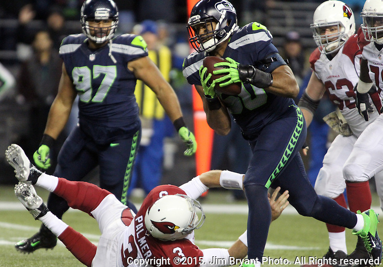 Seattle Seahawks linebacker K,J, Wright (50) picks up a fumble by Arizona Cardinals quarterback Carson Palmer (3) at CenturyLink Field in Seattle, Washington on November 15, 2015. The Cardinals beat the Seahawks 39-32.   ©2015. Jim Bryant photo. All Rights Reserved.